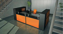 Receptiv reception desk with neon orange front panels and black base units