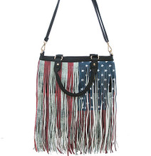 Make a statement with this American flag functional handbag made of textured faux leather featuring a fringe overlay.