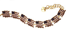 "American flag enamel and gold-plated linking bracelet. (Adjusts 6½"" to 8"")."