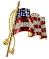 American flag brooch/pin with red enamel stripes and diamond-like Swarovski crystals as part of the stripes.The small diamond-like crystals that represent the stars are set on a blue enamel background in goldplate. A truly elegant piece!
