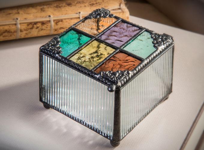 Box 815 multi-colored English muffle glass jewelry box by J. Devlin