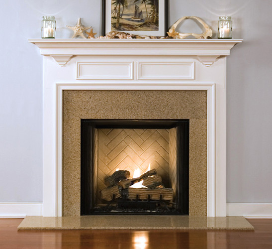 The two framed rectangle adds that special touch to the Winfield custom fireplace mantel.