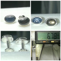 This items is the blue sapphire on the left in the photos.