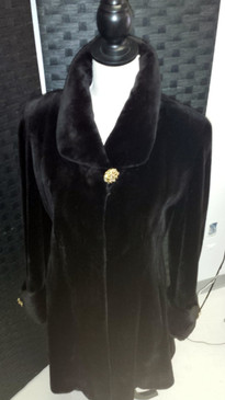 Dark brown sheared mink, flare bottom, turn back cuffs, gold buttons, light brown lining with matching silk scarf