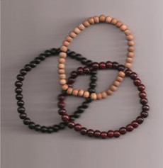 Two sets of rosewood, ebony and sandalwood bracelets