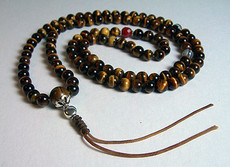 Tiger Eye natural stone mala made with fine-quality 8mm beads, strung on durable cording with 2 Dzi resting bead spacers and a Carnelian stone resting bead spacer in between sterling silver rings.
