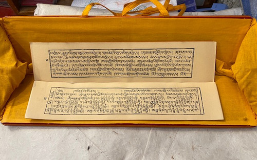 Om Ah Hum Bamboo, Brocade Text Holder shown with the sadhana inside