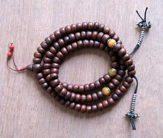 Barrel Bodhiseed Mala, 3 Silver Cap Amber counters with Tibetan bell and dorje accents.