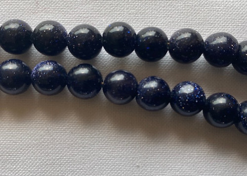 Close up of Medicine Buddha Blue stone and crystal mala, 8mm
