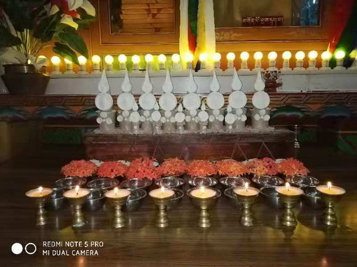 Tibetan Buddhist shrine with offerings where puja or sadhana are performed for healing,  removing obstacles and prosperity