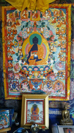 Medicine Buddha Thangka image on shrine where healing, health and prosperity puja is performed for the benefit of others.
