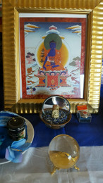 Medicine Buddha on shrine table, the healing Buddha of Compassion.