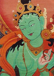 Green Tara Thangka close up. She's the feminine aspect of protection, represents compassion in action since she is in the process of stepping from her lotus throne in order to help sentient beings