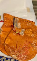 Saffron patterned large mala bag with beautiful designs