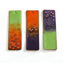 Torch fired enameling.