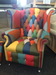 Multi-coloured leather with chrome legs. Single button facia.